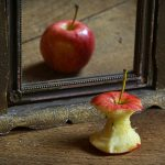 apple core looks whole in mirror as an expression of perception vs reality