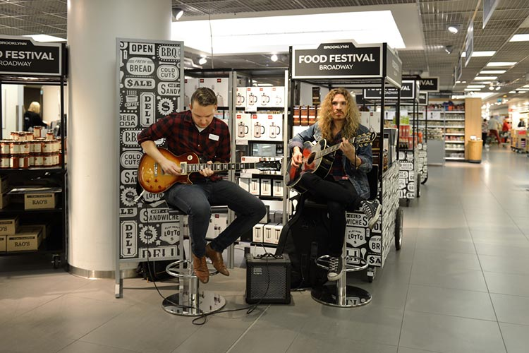 Two musicians helping music brand by performing at an in-store event