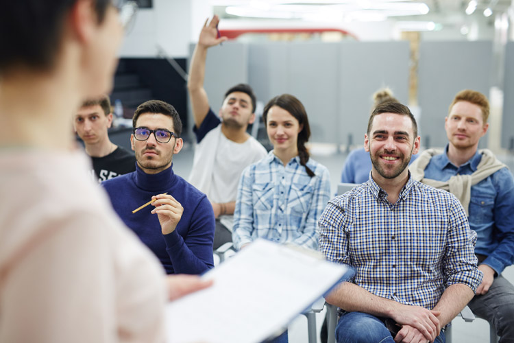 group of smiling employees in a training session