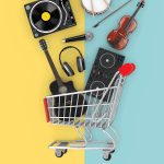 musical instruments and audio equipment in a shopping cart