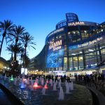 evening view of convention hall for the NAMM show with palm trees and fountain in the foreground