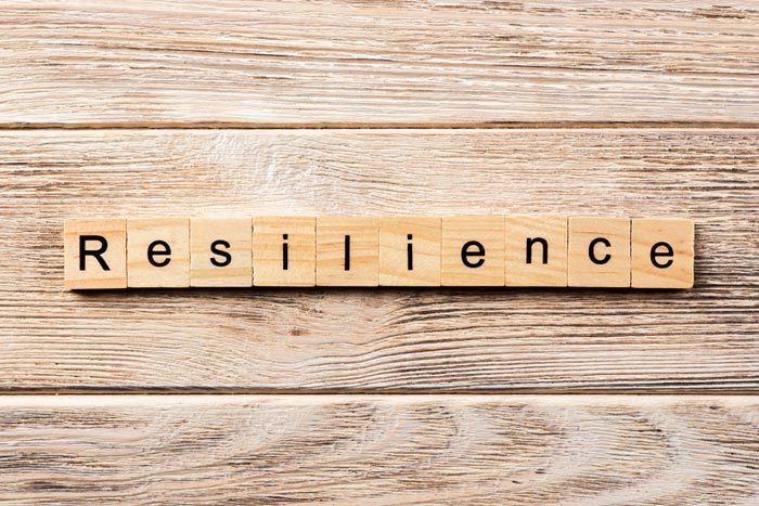 resilience spelled out in wooden tiles against a wood background